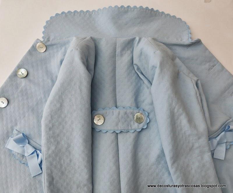 abrigo-con-adorno-ondulina-piquillo