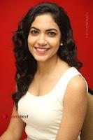 Actress Ritu Varma Stills in White Floral Short Dress at Kesava Movie Success Meet .COM 0184.JPG