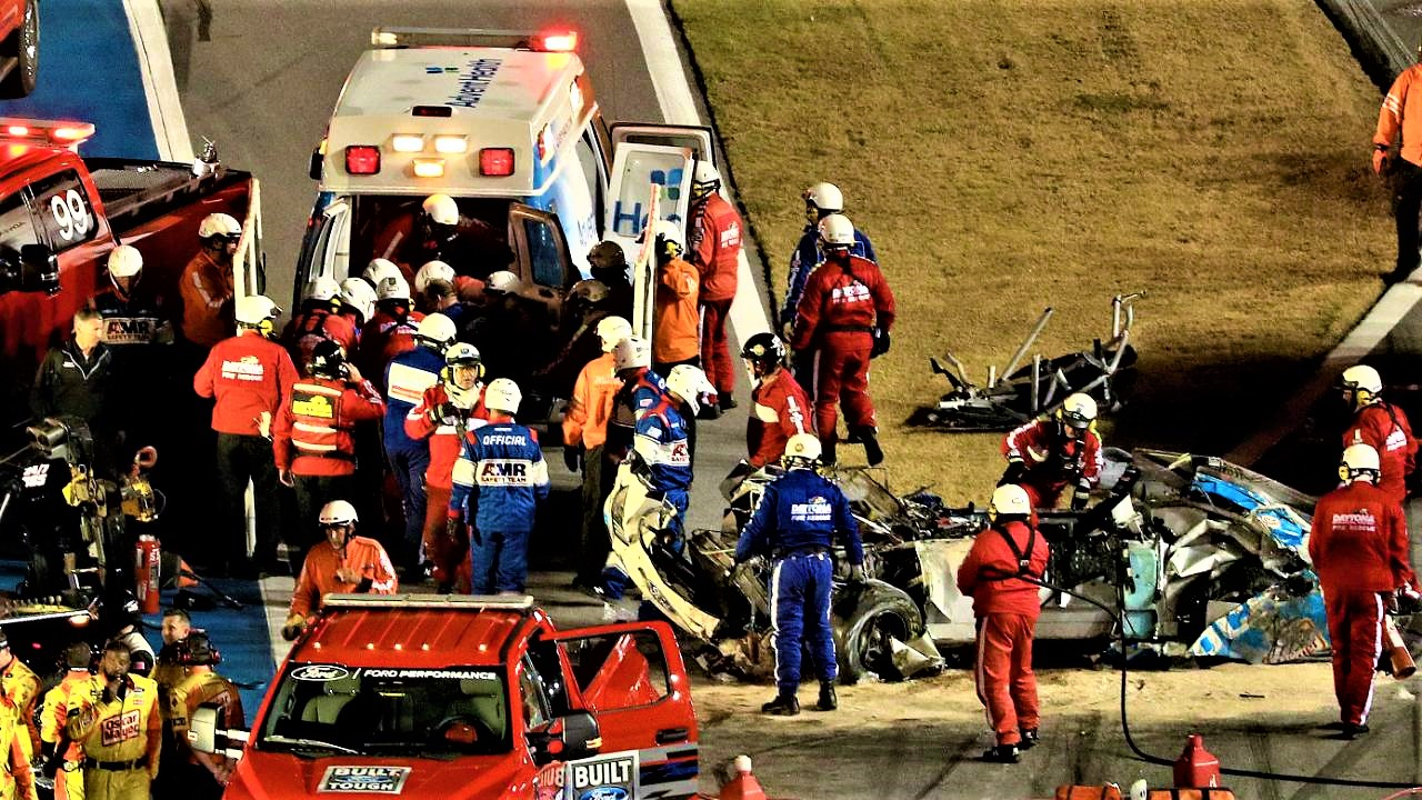 Doctors care for Newmann in an ambulance while the wreck is being recovered Photo: Mike Ehrmann / AFP.