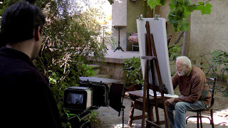 Carlos Ferragut con cámara en rodaje película Hekatombe y Ramiro Tapia al fondo