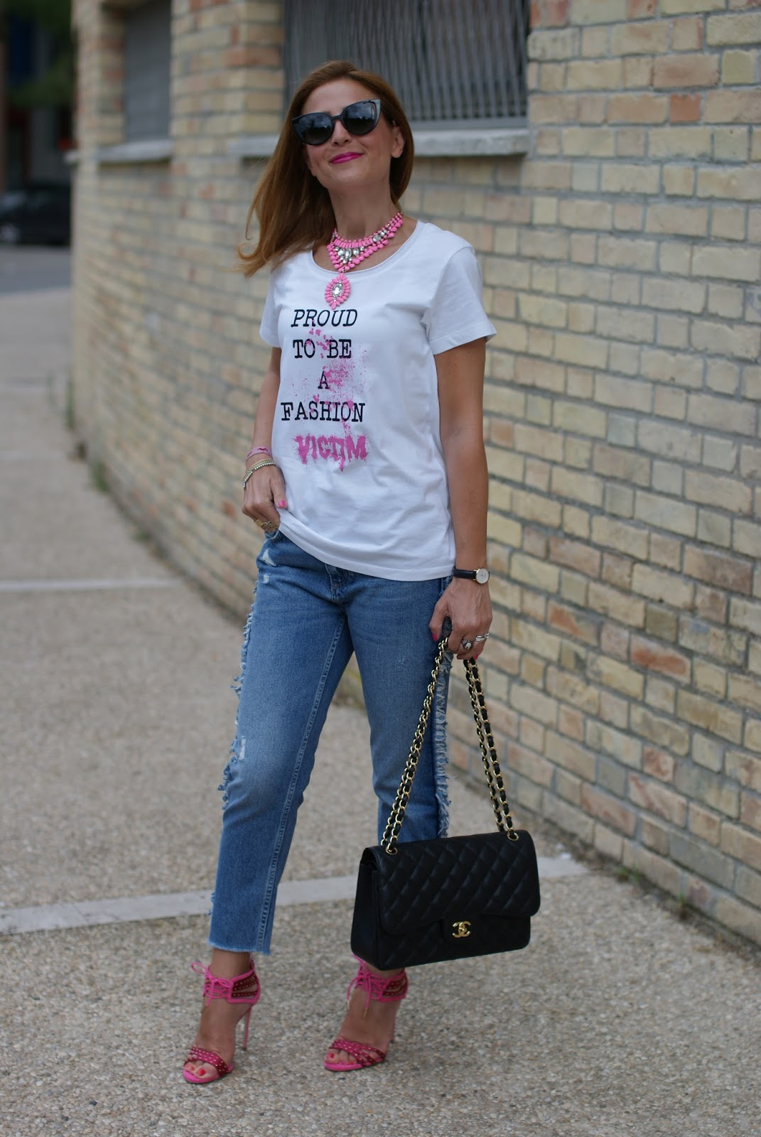 Casual feminine outfit with jeans, a proud to be a fashion victim t-shirt from TSoF Crew and Chanel bag on Fashion and Cookies fashion blog, fashion blogger style