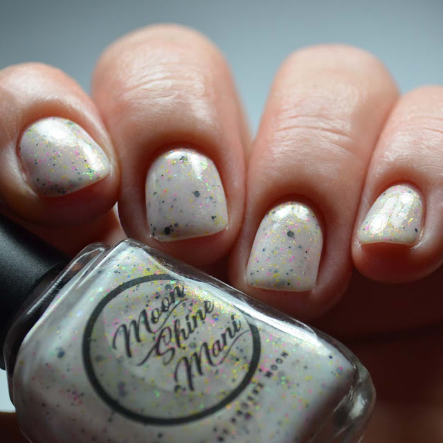 white nail polish with shimmer and colorful glitter different angle swatch