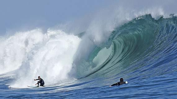 Surfing at Pichilemu Beach, Central Chile.