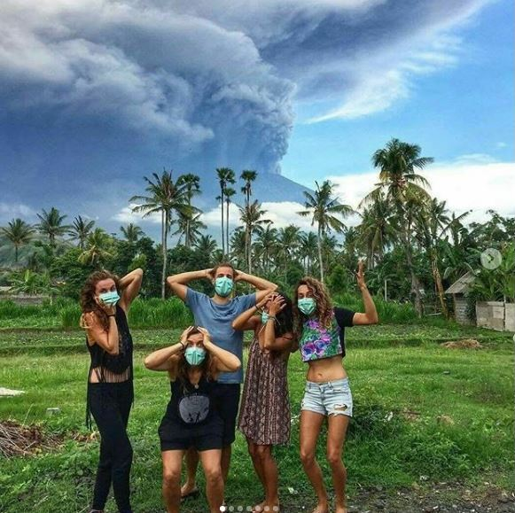 Mount Agung has become the new selfie destination, according to some reports, with tourists pausing outside the 10km exclusion zone for a quick snap.