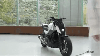 Moving Honda self-balancing motorbike