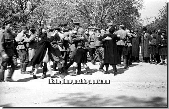 Soviet soldiers dance German girls