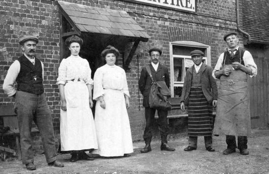 From left to right: Harry Goodman, landlord, Daisy Dickens, servant, Violet Goodman, wife The postman, butcher, and Parker the brewer outside The Woodman in the 1900s Image from G. Knott, part of the Images of North Mymms Collection