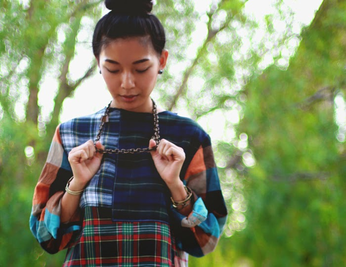 Stephanie Liu of Honey & Silk wearing Urban Outfitters Rag Union plaid dress, Kelly Wearstler chain necklace, and Michael Kors studded boots
