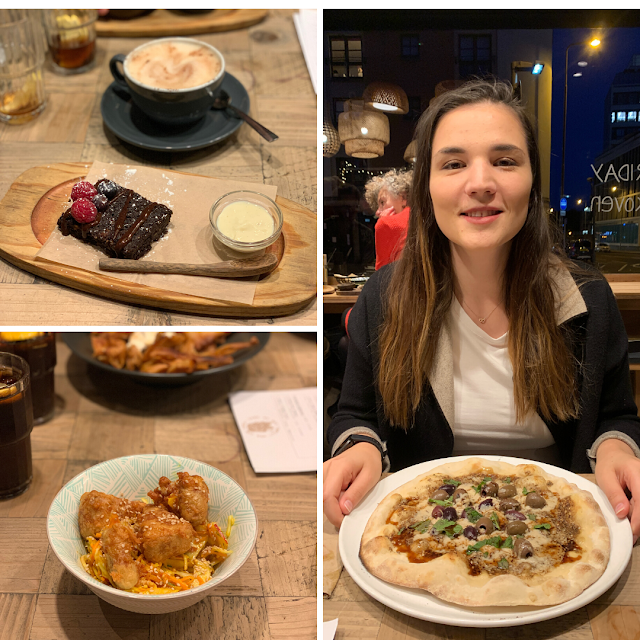 Vegan chocolate brownie in the top left corner with chai latte, the bottom left is Korean Sweet Chilli Jackfruit wings with slaw, the main photo on the right is myself smiling with Lebanese style pizza
