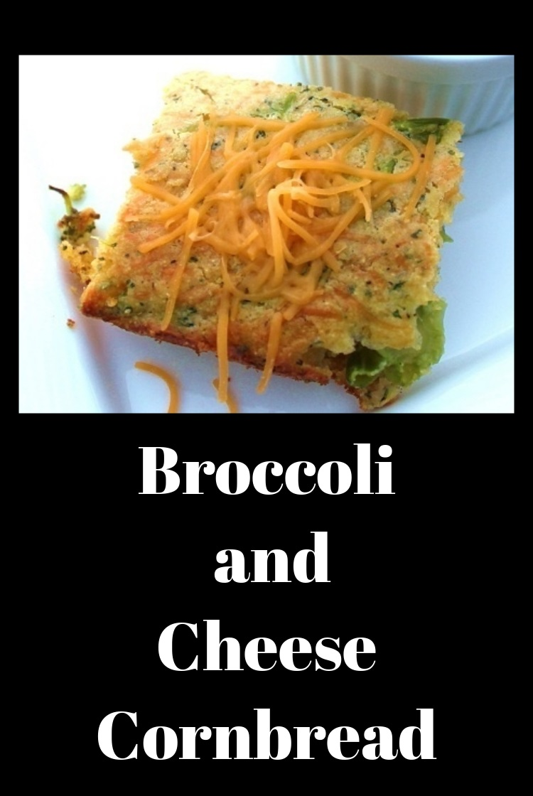 broccoli cheese bread cut in squaress topped with shredded cheddar