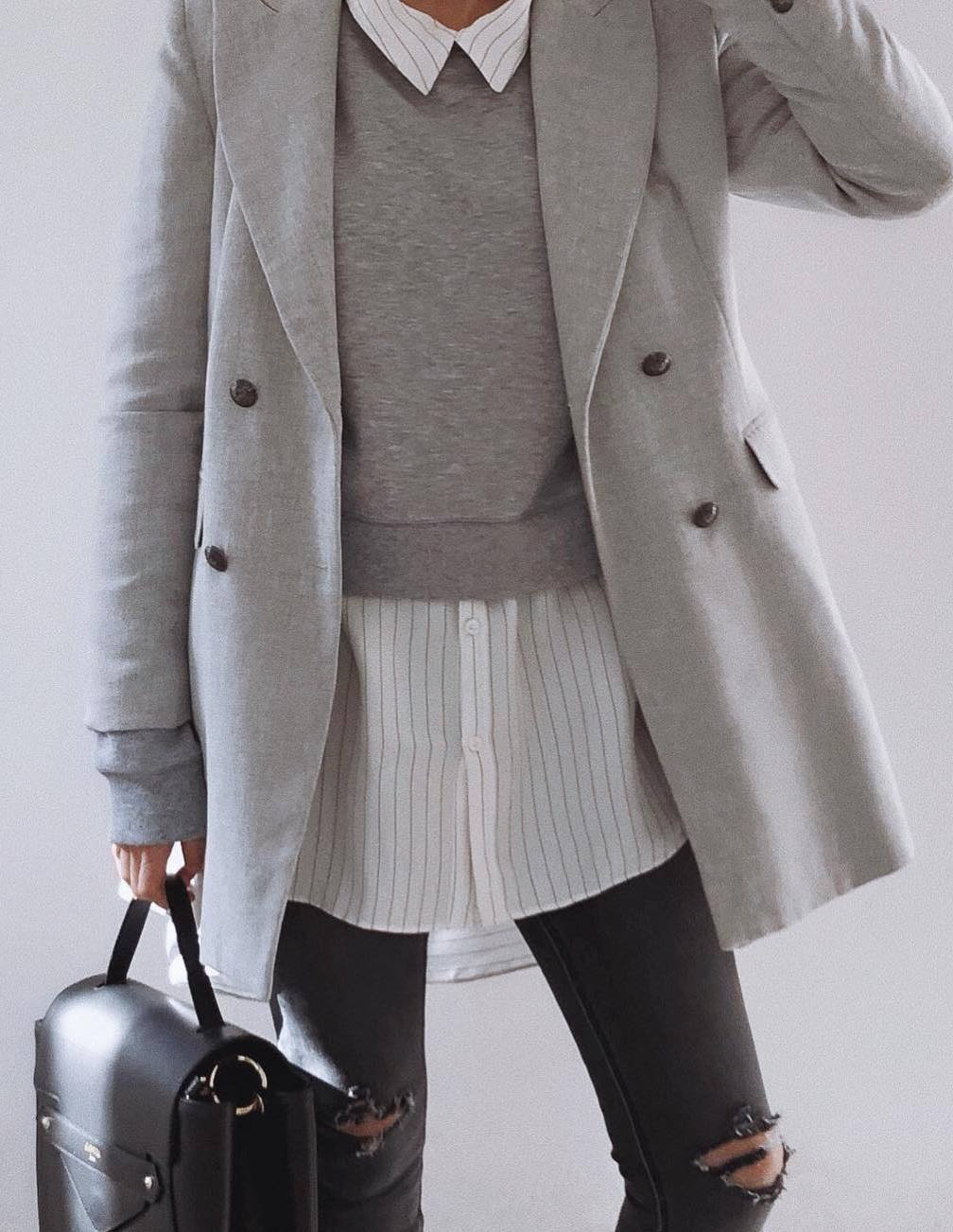 cute fall outfit idea / sweatshirt + grey coat + striped shit + bag + jeans