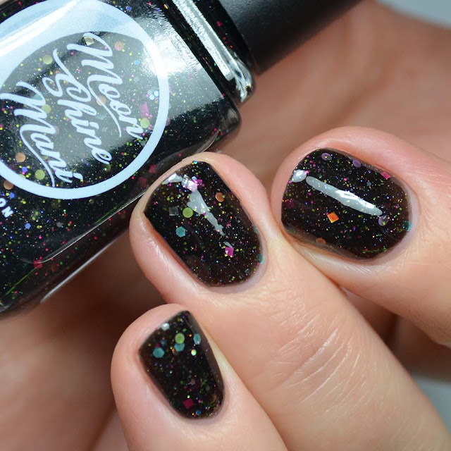 black nail polish with rainbow glitter swatch
