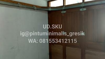 pintu garasi minimalis gresik surabaya sidoarjo mojokerto lamongan