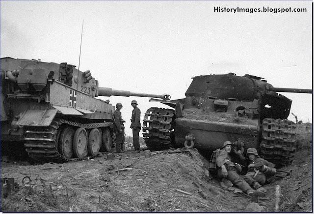 German soldier beside a Tiger tank and a destroyed Soviet KV-1 tank at Lake Ladoga Leningrad September 1943