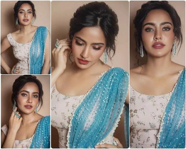 Neha Sharma Wavy Bun