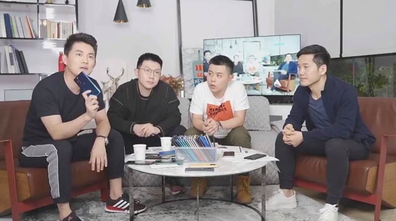 The man sitting at the leftmost holds the dummy of OnePlus 8 Lite