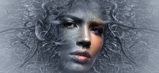 A girl depicted with black charcoal and blue eyes.