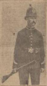 Policeman with shot gun