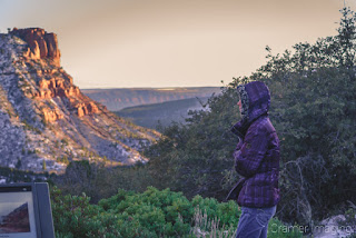 Behind-the-scenes photograph of photographer Audrey Cramer scouting out a shot at Kolob Canyon Zion National Park Utah