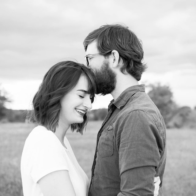 Black and white couple kiss forehead cypress street home
