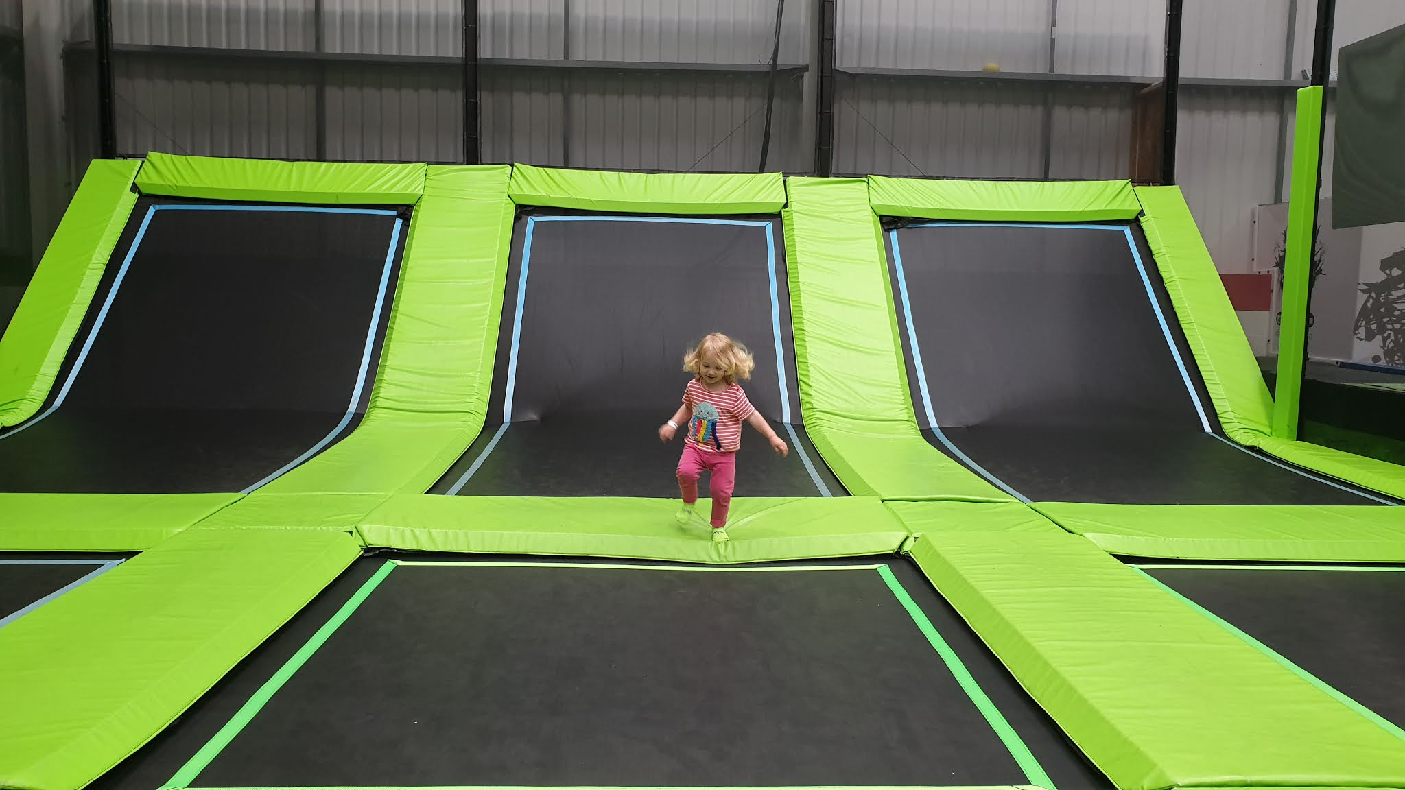 toddler running to a trampoline