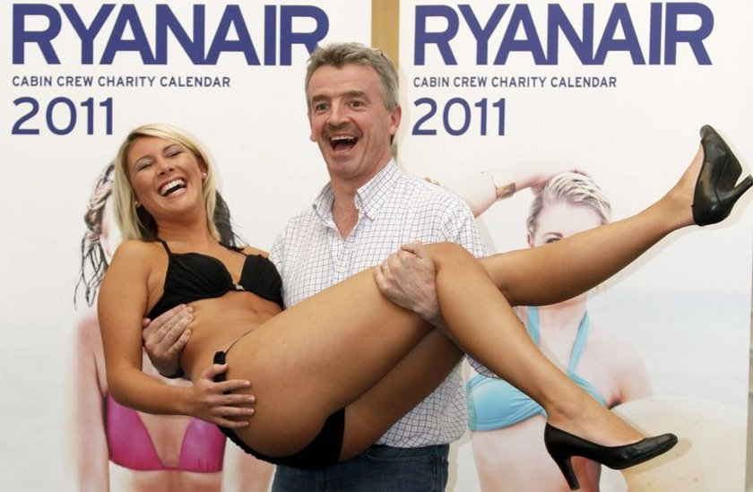 Irish budget carrier Ryanair featuring female cabin crew posing in bikinis.