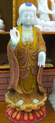 White Buddha statue from jadeite with ruby and gold dust