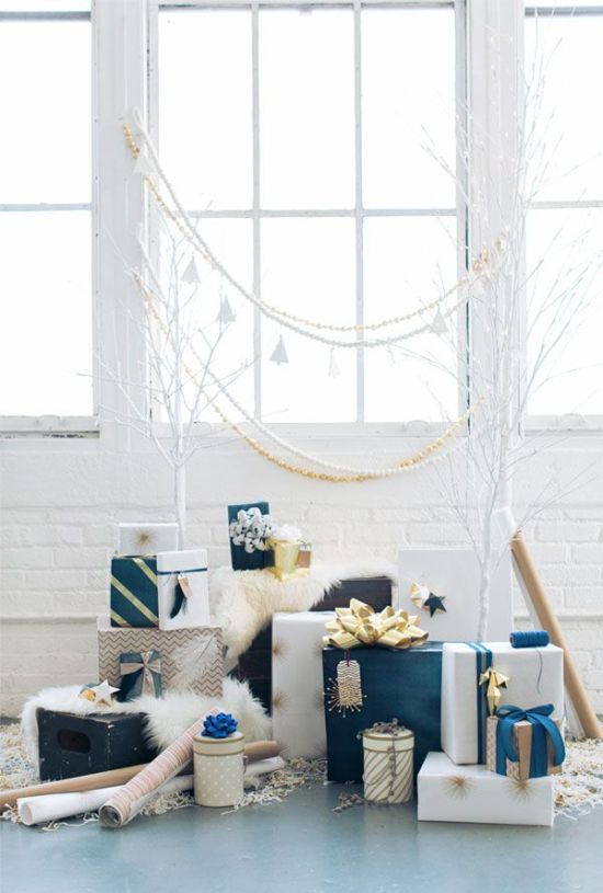 blue, white, neutral and gold Christmas gifts