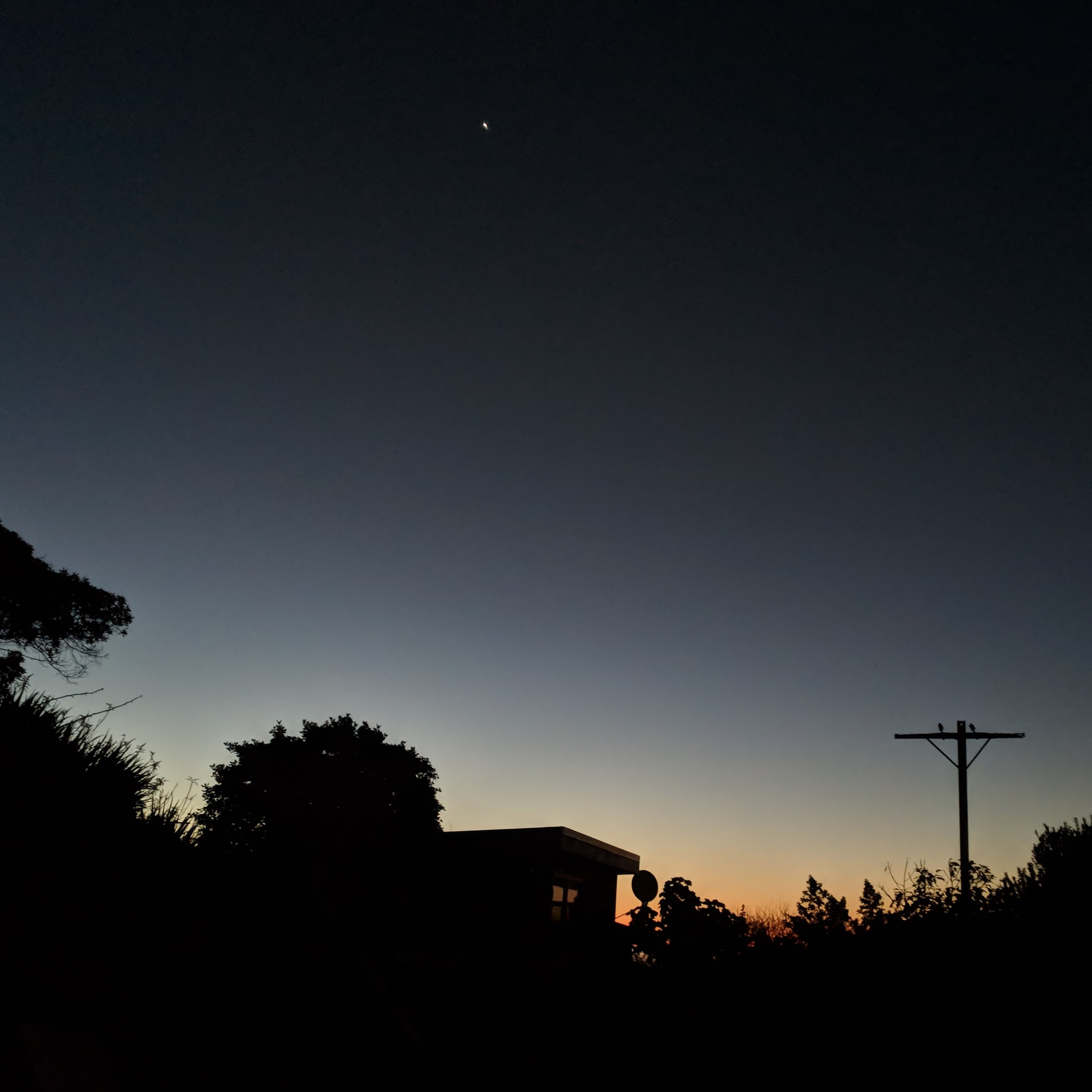 Clear sunset over Paekākāriki houses with Venus in view