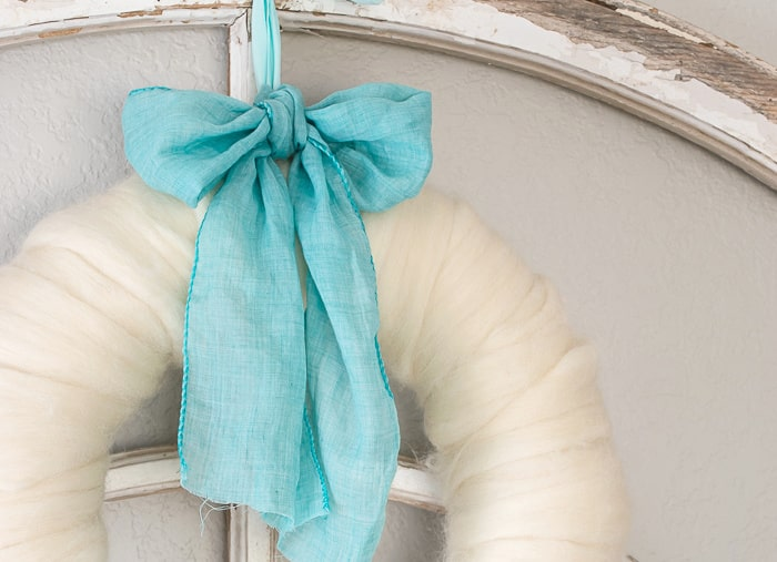 wool wreath with turquoise ribbon