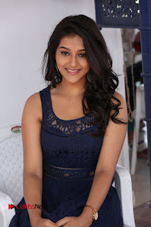 Actress Pooja Jhaveri Stills in Short Dress at Dwaraka Movie Interview  0160.JPG