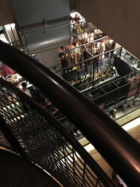 Jamie's Italian, Cardiff. View through railings at downstairs bar