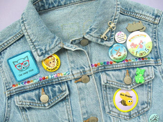 Denim jacket customised with pins, sequins and custom patches