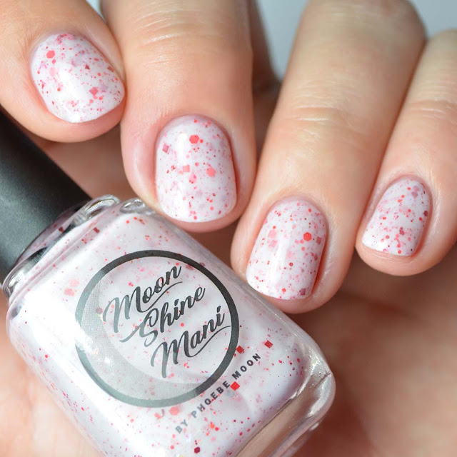 white crelly nail polish with red glitter