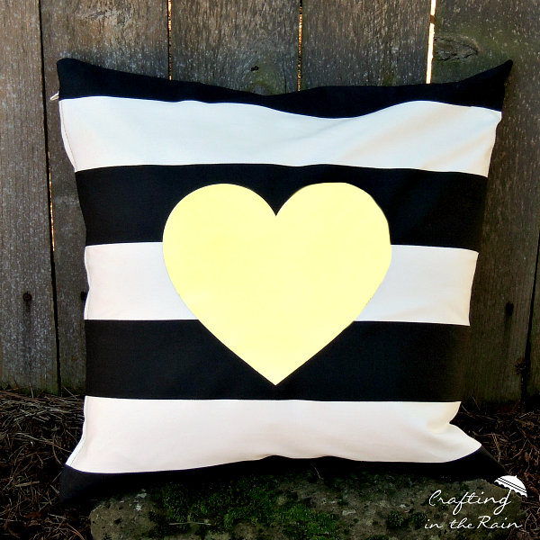 Gold heart on striped pillow
