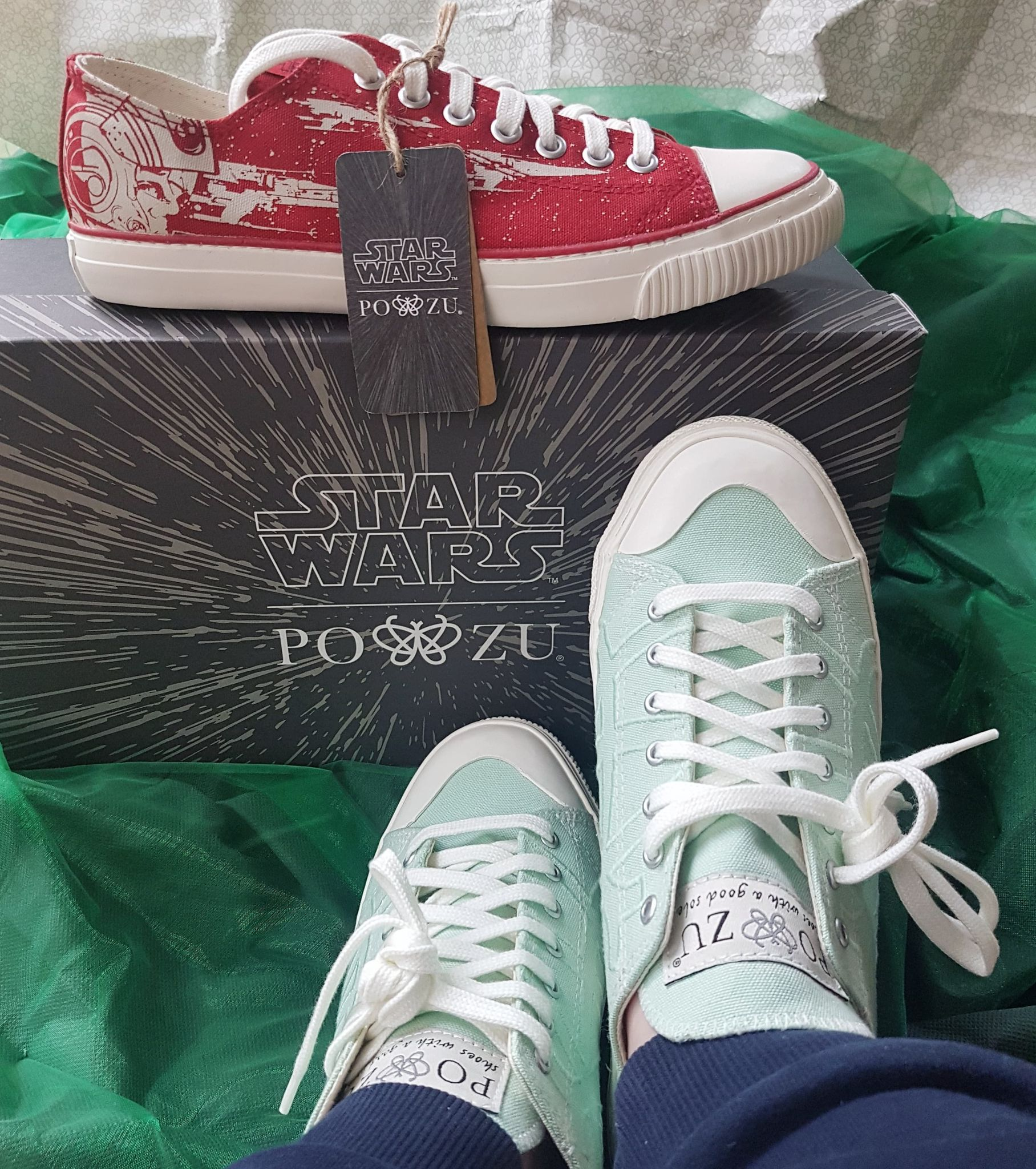 red Star Wars shoes and mint green shoes with white laces