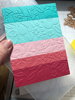 Make a beautiful striped embossed background with embossing folders and paper scraps for colorful handmade cards.