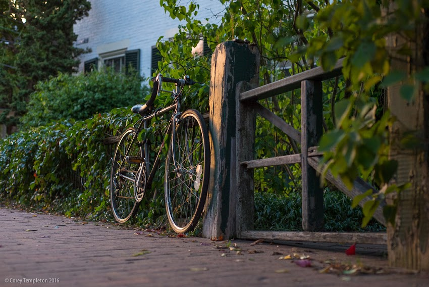 Portland, Maine USA September 2016 photo by Corey Templeton of a cool bicycle parked along a fence on Brackett Street in the West End.