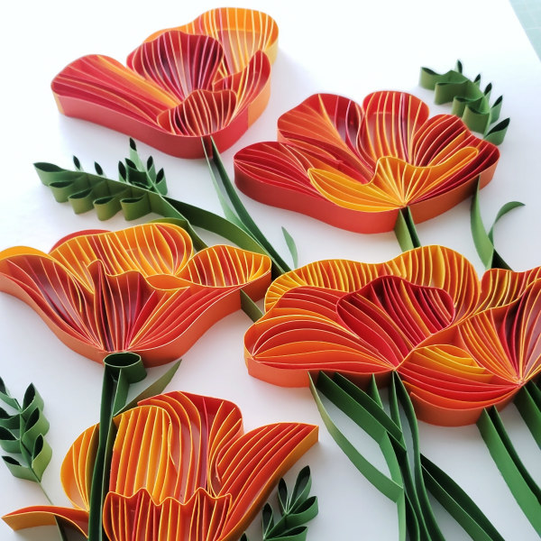 on-edge orange quilled flowers made of paper