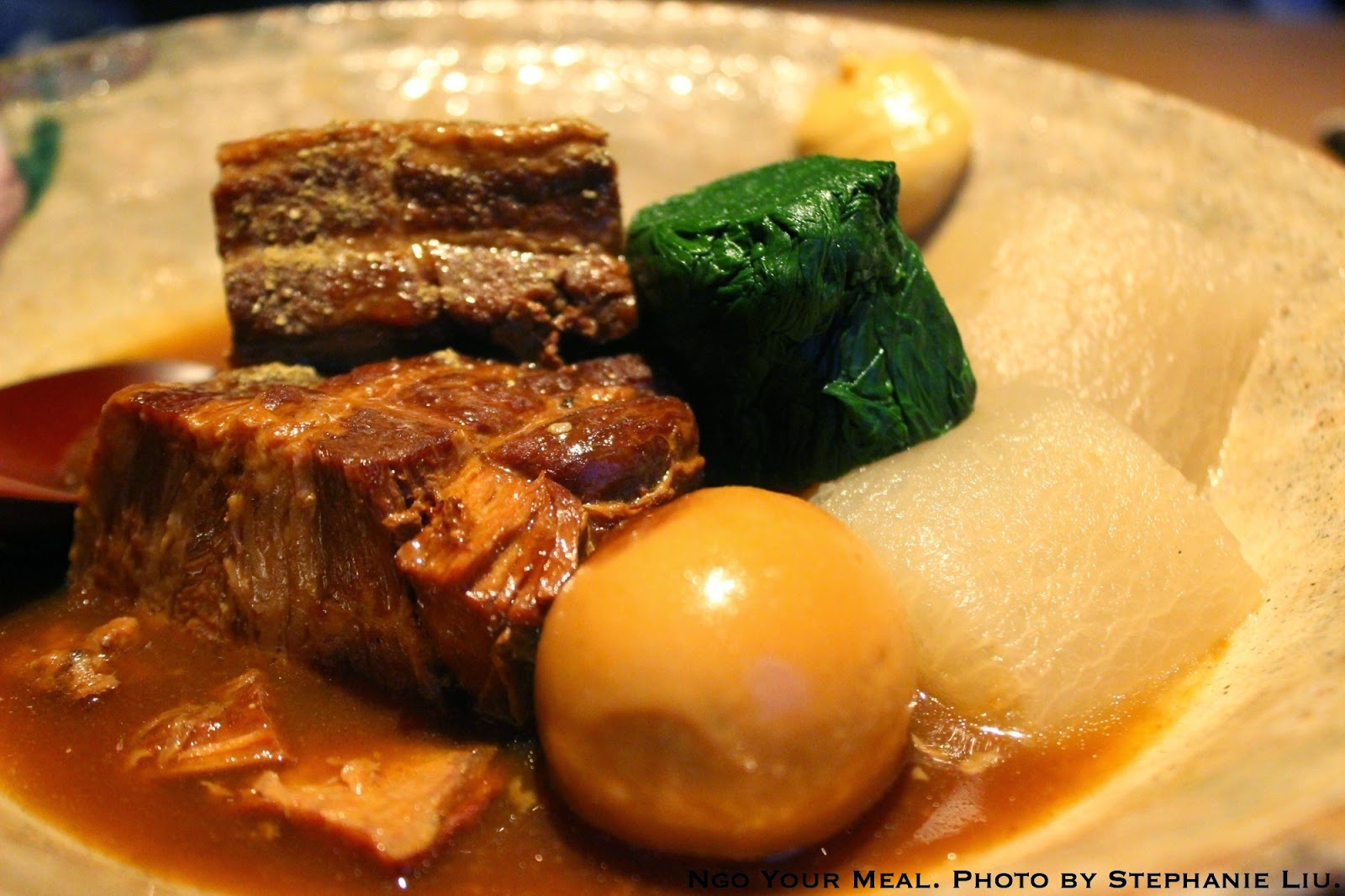 Kurobuta Kakuni: Braised Berkshire pork belly in sansho miso served with a hard boiled egg, spinach and daikon radish at En Japanese Brasserie