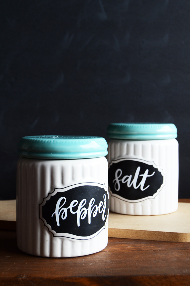 spice labels on chalkboard canisters