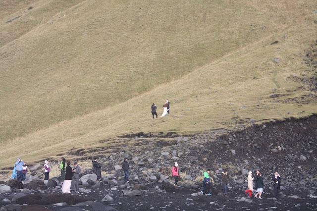 Wedding pictures being taken at Reynisfjara in Iceland.