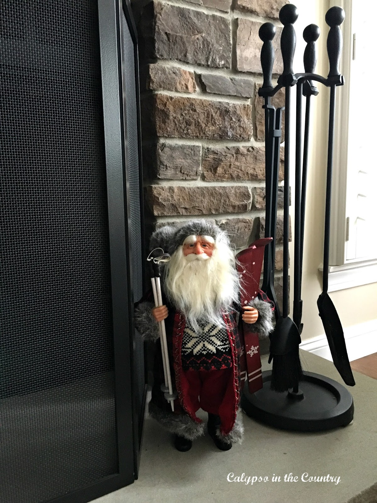Skiing Santa in front of Stone Fireplace