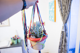 how to make easy DIY Macrame Plant Holders from old tie dye T-shirt fabric yarn, the perfect summer craft for the whole family (kids too!)