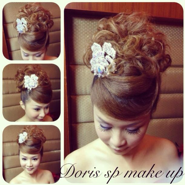 bold hairdo with white flower