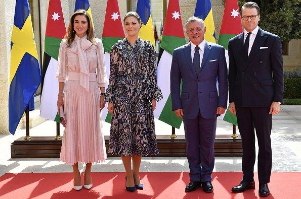 Crown Princess Victoria wore Samsøe&Samsøe Joanna ss shirt and Cathy skirt and By Malene Birger pumps. Queen Rania
