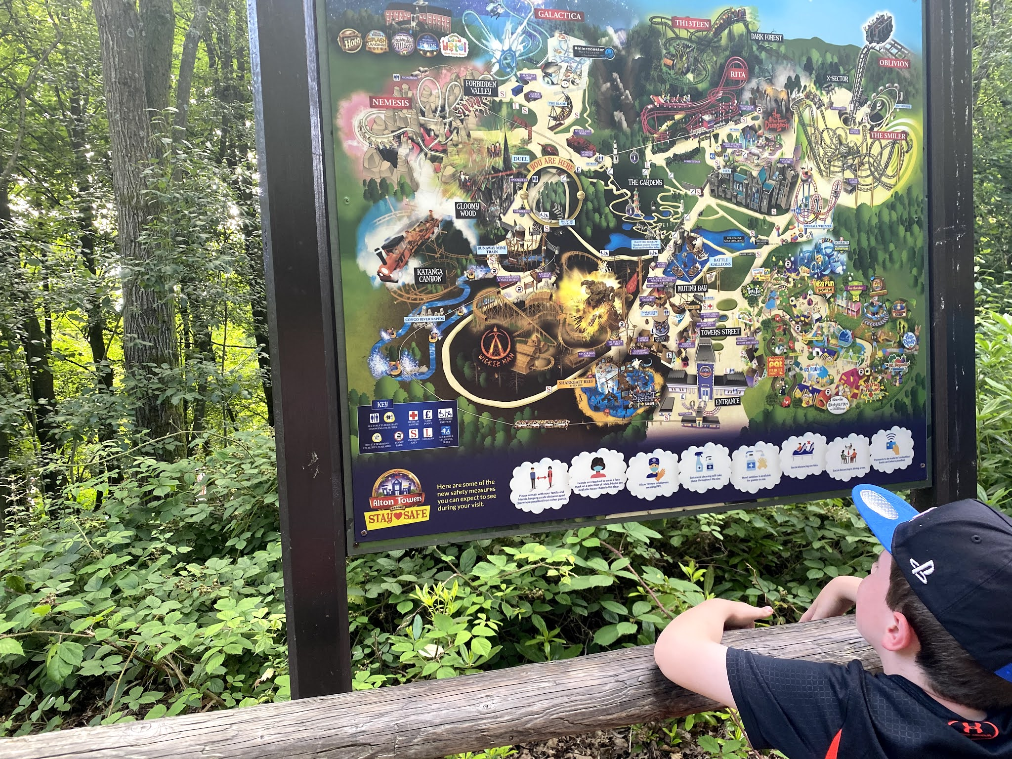 boy looking at an Alton Towers map