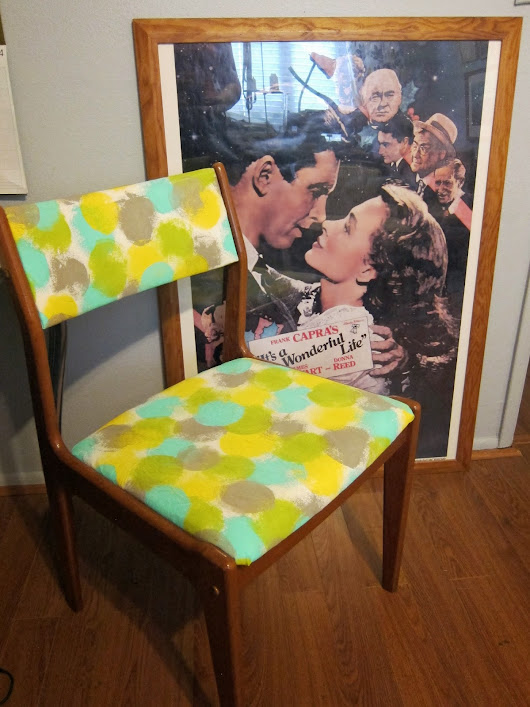 Custom painted fabric on a teak wood chair from the 1970's