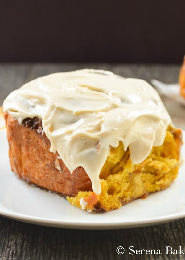 Pumpkin Cinnamon Rolls With Maple Cream Cheese Frosting  are perfectly balanced with notes of vanilla, cinnamon, ginger and nutmeg with a sticky gooey cinnamon, brown sugar, honey filling and covered with a sweet maple cream cheese frosting. These are so good you won't just eat the center from Serena Bakes Simply From Scratch.