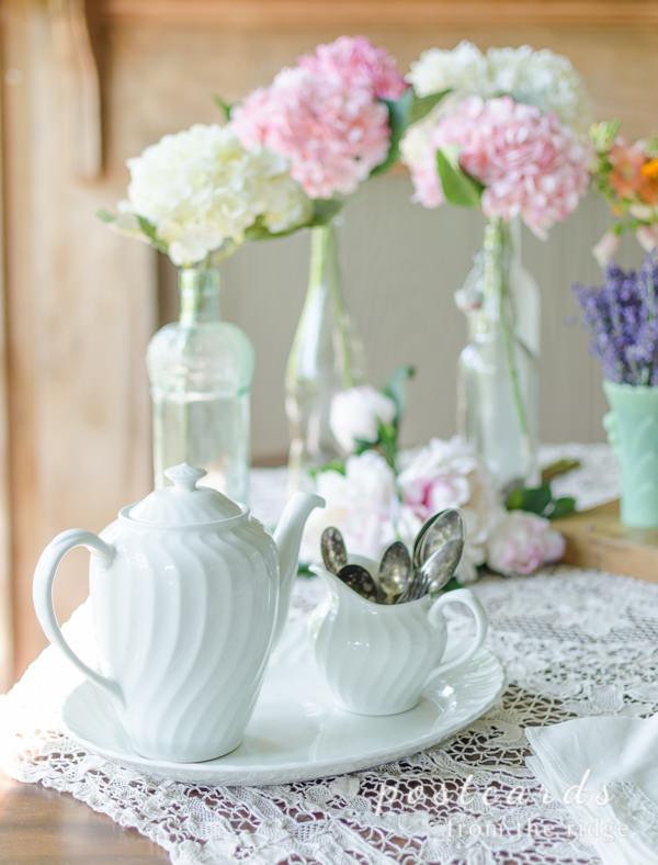 vintage white ironstone teapot with vintage linens